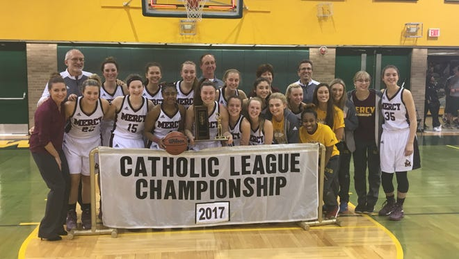 Mercy's players pose for a team photo Sunday at Wayne State after winning the Catholic League title.