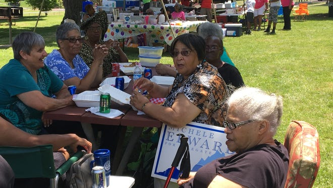 A group of woman talk and spend time together at the first annual Staunton Juneteenth Day celebration on Saturday in Montgomery Hall Park.