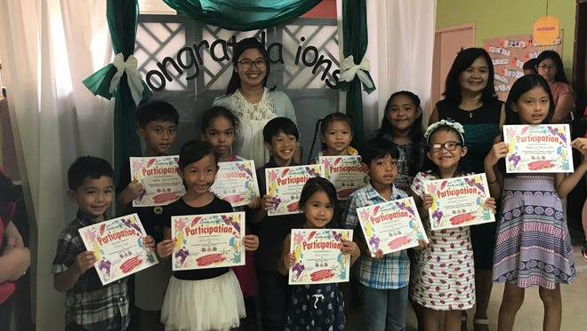 The Young Learner Center awarded their Summer Program participants with certificates. Pictured, from left: Ashton Weger, Reden Pangilinan, Gabrielle Cruz, Venecia Camacho, Aliza Banico, Darien Siaotong, Kairi Castro, Sierra Grino, Vincent Camacho, Tommie Jae Sablan, Kaliyah Parinas, Cora San Nicolas and Rhekyla Pangilinan
