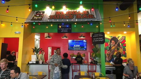 The new Island Delight location at 36 Dexter Ave. features colorful decor designed by owner Melissa Smith.