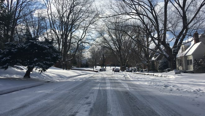 Neighborhood streets such as Maplemere Drive in Clarksville were still covered in icy slush on Saturday morning.