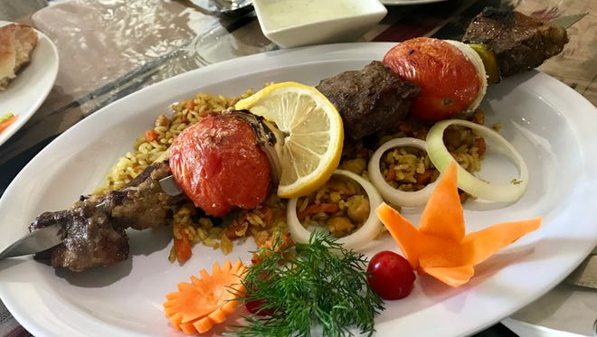 A specialty kebab with lamb and beef from Silk Road in south Fort Myers.