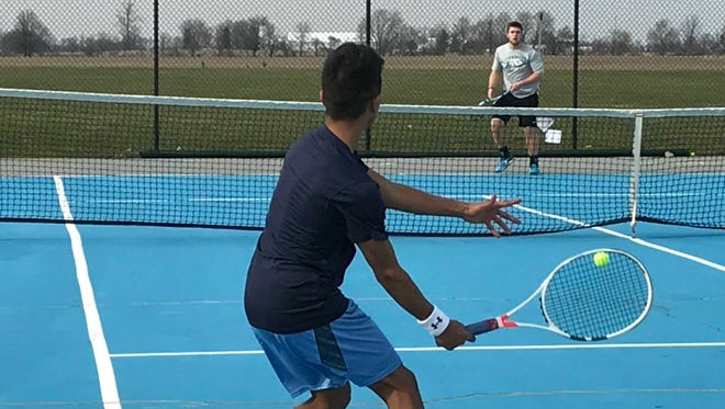 River Valley's Patrick Ravi (foreground) gets set to return a volley to Clear Fork's Noah Brown Friday afternoon at River Valley.