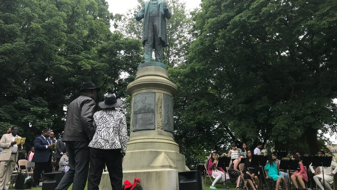 During the Frederick Douglass Freedom Festival on Saturday, a wreath was put at the bottom of his statue in Highland Park by Joan Coles Howard and Tarence Bailey.
