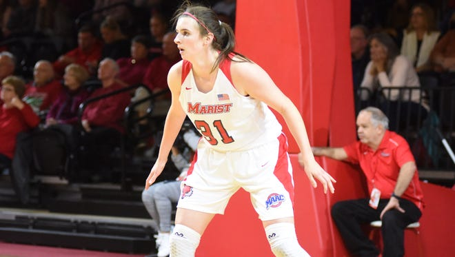 Marist College's Molly Smith sets on defense against Navy at McCann Arena in Poughkeepsie on Friday.