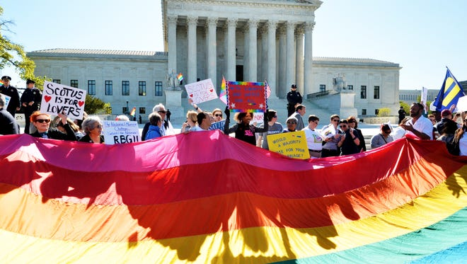 Supporters of same-sex marriages gather outside the U.S. Supreme Court waiting for its decision on April 28, 2014 in Washington, DC. The US Supreme Court is hearing arguments on whether gay couples have a constitutional right to wed -- a potentially historic decision that could see same-sex marriage recognized nationwide.