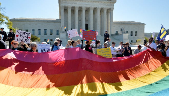 Supporters of same-sex marriages gather outside the US Supreme Court.