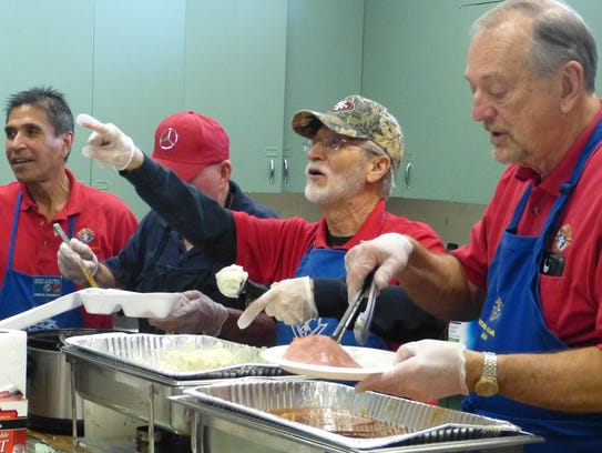 More than 100 Christmas dinners were served Monday