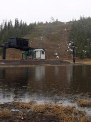 A large puddle builds around the bottom of the hill Feb. 7 at Hoodoo Ski Area, which has virtually zero snow.