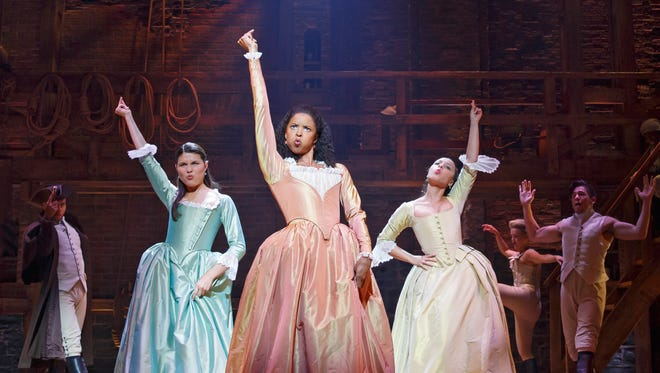 Phillipa Soo, left, Renee Elise Goldsberry and Jasmine Cephas Joness in a scene from the Broadway musical 'Hamilton.'