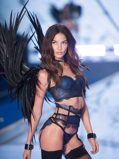 A nightbird walks the runway at the Victoria Secret's