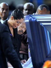 Monica Morgan-Holiefield, widow of General Holiefield, grieves as she and others attend her late husband's funeral at Greater Grace Temple in Detroit, Tuesday, March 17, 2015.  (Todd McInturf , The Detroit News)
