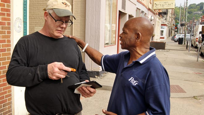David Lee Grier Sr., right, talks with Joe Tucker, owner of Tucker's Restaurant in Over-the-Rhine. The restaurant has been closed since a fire July 27. Tucker said he hopes to re-open in four to six weeks.