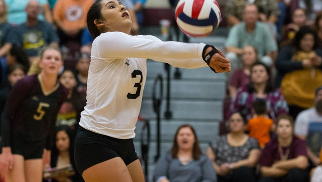 Tuloso Midway's Lauren Gonzalez bumps the ball during the first match against Gregory Portland's at Tuloso-Midway High school on Tuesday, Sept. 26, 2017.