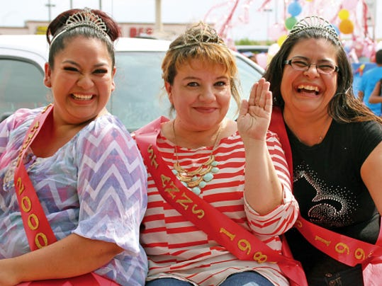 Bill Armendariz - Headlight Photo Past St. Ann Fiesta Queens rode in Saturday's parade. These three are family members. From left are: Renee Rivera (2000), Bernadette Esparza (1989) and Marissa Esparza (1992).