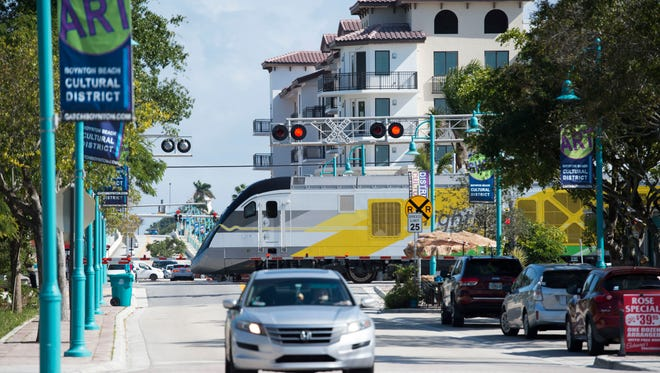 A Brightline train traveling north crosses East Ocean Avenue and Northeast Fourth Street on Thursday in Boynton Beach. On Wednesday, Jeffrey D. King, 51, of Boynton Beach, was killed by a train when he pedaled around the gates, the second fatality by a Brightline train in a week.