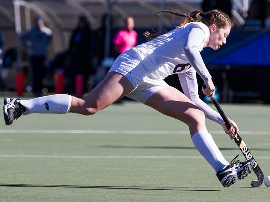 Middlebury's Grace Jennings looks to move the ball during Sunday's NCAA championship game against Bowdoin.