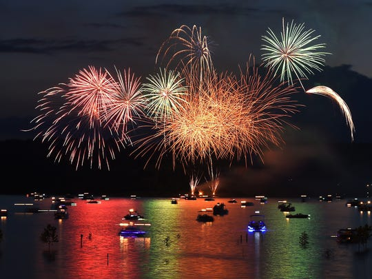 Fireworks explode over Norfork Lake during the 30th annual Independence Eve Fireworks Show on July 3, 2015. Several fireworks shows are planned for later this week around the Twin Lakes Area.