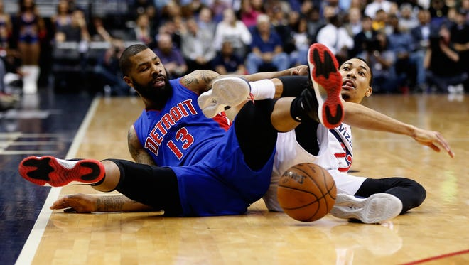 Marcus Morris, left, of the Detroit Pistons and Otto Porter Jr. of the Washington Wizards go after a loose ball March 14, 2016, in Washington, DC.