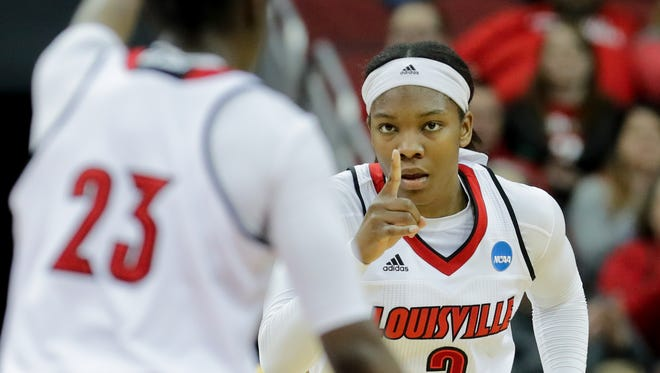 Louisville's Myshia Hines-Allen thanks Jazmine Jones for the assist.