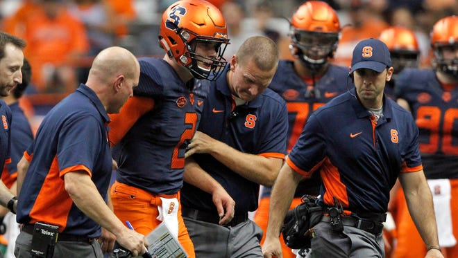 Syracuse's Eric Dungey, second from left, is helped off the field after getting injured in Saturday's game against Central Michigan in Syracuse.