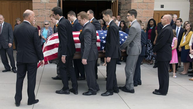 Grandsons of Mormon leader Richard G. Scott carry his casket out of the Tabernacle following funeral services in Salt Lake City, Monday. Scott died Sept. 22 from natural causes at the age of 86.