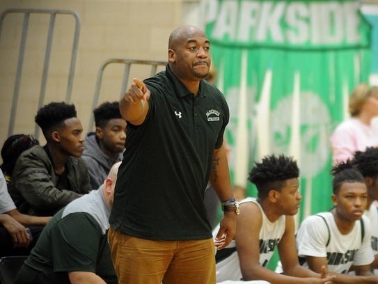 Parkside assistant coach Shawn Tucker signals to a