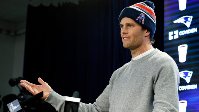 """FILE - In this Jan. 22, 2015, file photo, New England Patriots quarterback Tom Brady speaks at a news conference about the NFL investigation into deflated footballs, in Foxborough, Mass. An NFL investigation has found that New England Patriots employees likely deflated footballs and that quarterback Tom Brady was """"at least generally aware"""" of the rules violations. The 243-page report released Wednesday, May 6, 2015, said league investigators found no evidence that coach Bill Belichick and team management knew of the practice."""