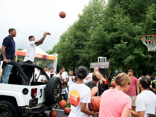 """NBA stars Jalen Rose, left, and Paul George shoot hoops from a Jeep during Jeep's """"Summer of Jeep"""" event at Navy Pier on Thursday, July 28, 2016, in Chicago."""