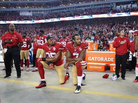 San Francisco 49ers Eric Reid (35) and Colin Kaepernick