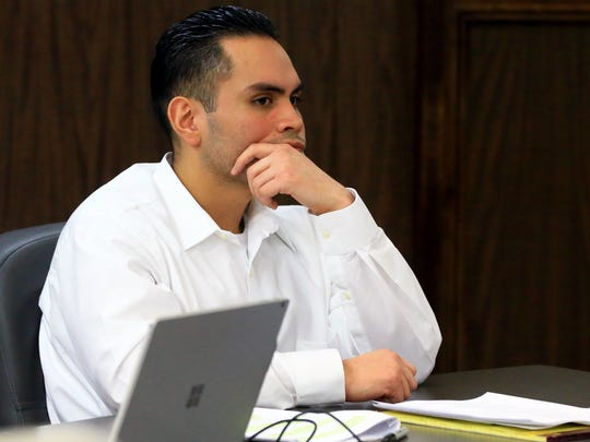 Heriberto Saenz watches as prosecutor Mike McCaig gives his closing argument Tuesday. A jury later found Saenz guilty of murder and three counts of aggravated assault for a 2009 shooting.