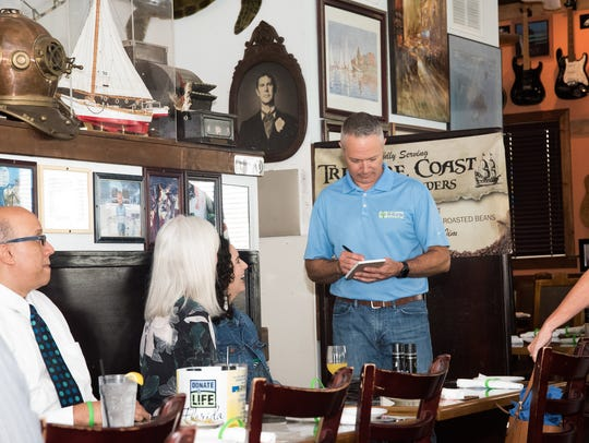 St. Lucie County Tax Collector Chris Craft takes guests'