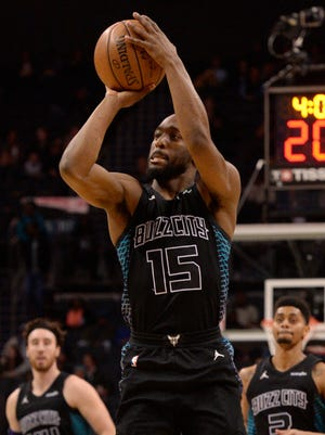 Hornets guard Kemba Walker shoots a three-pointeragainst the Grizzlies at the Spectrum Center.  The Hornets won 140-79.