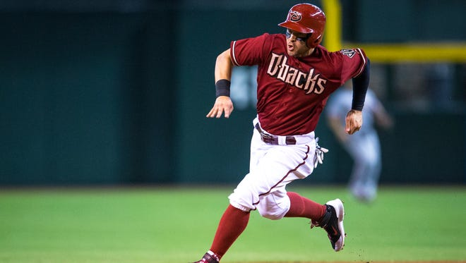 Arizona Diamondbacks' Cody Ross heads to third base in the second inning as the DBacks play the San Francisco Giants at Chase Field in Phoenix, on Wednesday, Sept. 17, 2014.