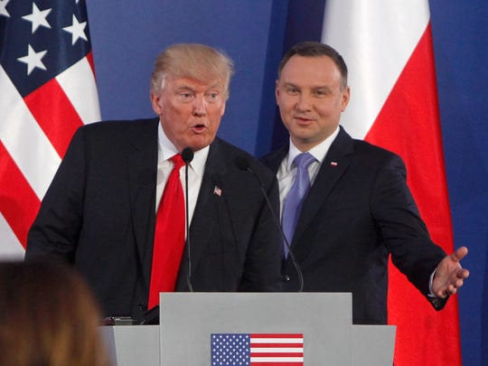 President Donald Trump (left) speaks as Poland's President Andrzej Duda gestures at the end of a joint news conference Thursday, July 6, 2017, in Warsaw, Poland. The media event was Trump's first overseas news conference.