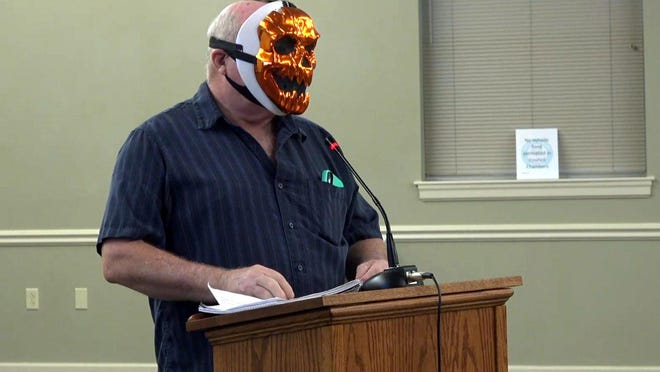 DeBary resident Mort Culligan makes a statement, visually and verbally, during the public comment part of the City Council's special meeting on a resolution encouraging face coverings during the coronavirus pandemic on Wednesday, July 15, 2020.