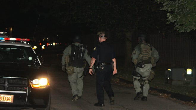Police said that two suspects were taken into custody after the SWAT standoff in Colerain Township Sunday night.