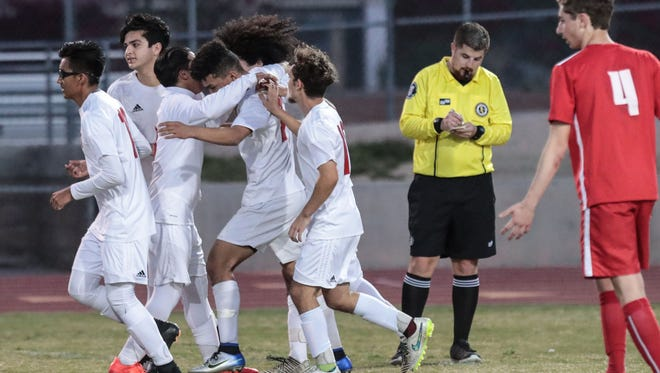 Palm Desert celebrate Jhonatan Urbina's goal against Woodbridge in the closing minutes of the first half during a playoff game on Friday, February 16, 2018 in Palm Desert.