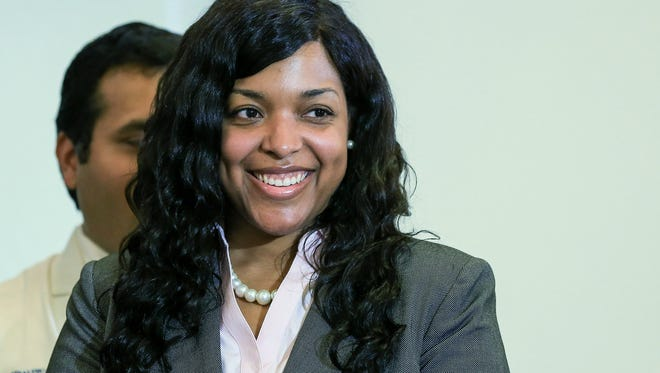 Amber Vinson, a Texas nurse who contracted Ebola after treating an infected patient, stands during a press conference after being released from care at Emory University Hospital on August 1, 2014 in Atlanta, Georgia. Vinson, a nurse at Texas Health Presbyterian Hospital Dallas, contacted Ebola after treating Ebola patient Thomas Eric Duncan, who later died of the disease.