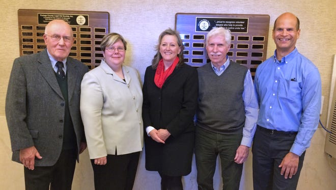 Attorneys stand with plaques recently unveiled in the County-City Building. Pictured are Maury Rice, past president of the Portage County Legal Aid Society and commissioner of Wisconsin Access to Justice Commission, Melissa Dalkert, president of the Portage County Legal Aid Society, Patricia Baker, president of the Portage County Bar Association, Judge James Gramling, president of the Wisconsin Access to Justice Commission, and Jeff Brown, Wisconsin Bar Association pro bono coordinator.