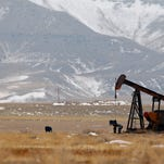 A pump jack pulls crude from an underground reservoir in an oil field in northern Toole County.