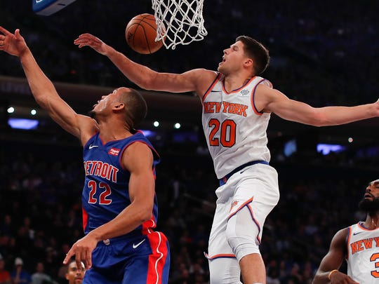 New York Knicks forward Doug McDermott (20) blocks a shot by Detroit Pistons guard Avery Bradley (22) during the first quarter of an NBA basketball game, Saturday, Oct. 21, 2017, in New York.