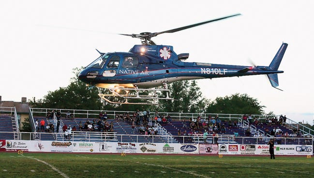 In this file photo, a Native Air medical ambulance, owned by Air Methods Corp., lands on a football field in Deming, New Mexico.