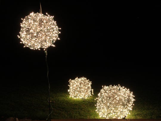 Form chicken wire into giant spheres and wrap in Christmas lights for a glowing display in your yard.