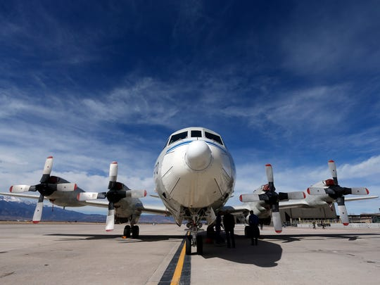 This Feb. 17, 2017, photo shows a Navy P-3 Orion aircraft used for a NASA-led experiment called SnowEx, on an airfield at Peterson Air Force Base in Colorado Springs, Colo. Instrument-laden aircraft are surveying the Colorado high country this month as scientists search for better ways to measure how much water is locked up in the world's mountain snows - water that sustains a substantial share of the global population.