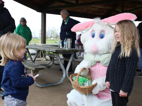Ben Griffith, 2, meets the Easter Bunny for the first time on Saturday with his cousin Elsie Critchfield, 4.