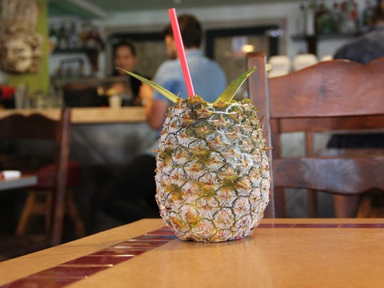 The Super Pina, a blended pina colada with Rumchata and passionfruit, is served in a frozen pineapple at Casa Rojas.