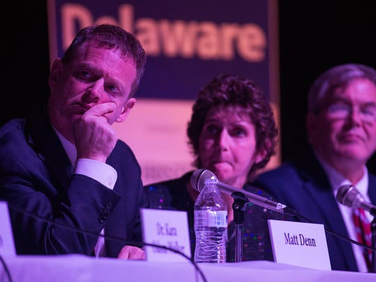 Delaware Attorney General Matt Denn listens during the Imagine Delaware What Heroin Costs Delaware forum Monday night at John Dickinson High School.