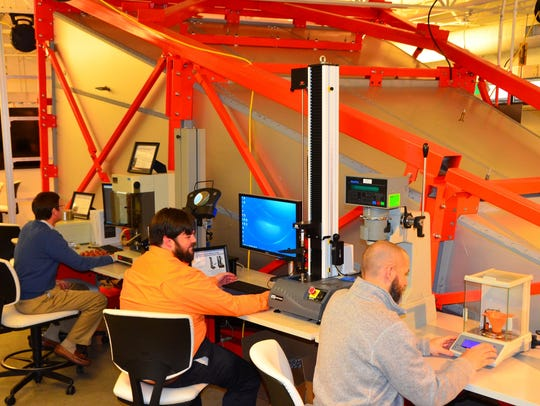 Engineers from Knoxville's AMS Corporation try out