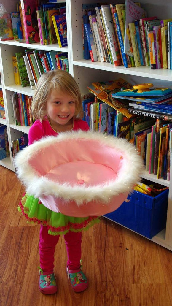Meaghan Werzinger had chosen a pink fluffy dog bed for her two pretend dogs Cassie and Cinderella.
